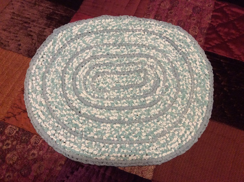 cream and grey oval rug