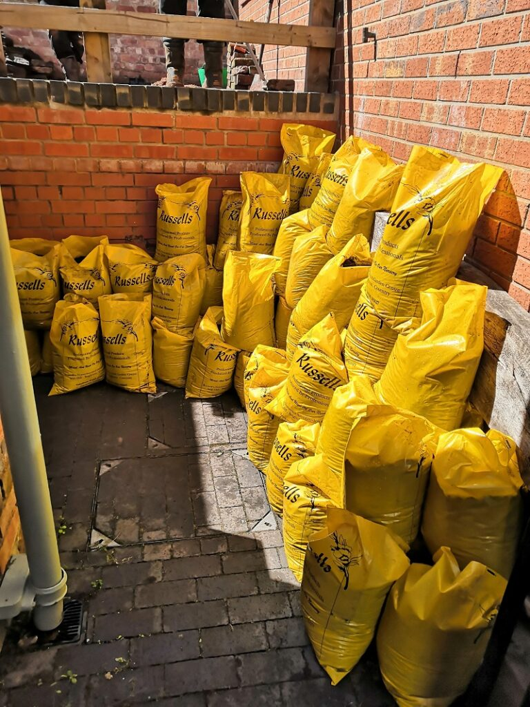 many bright yellow bags of sand and gravel
