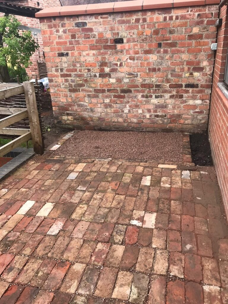 completed paved area, made of old weathered bricks