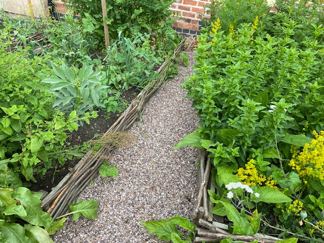 neat garden paths and hurdle edged beds